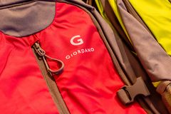 New red Giordano bag pack and its zip shown to the customer in Blueport shopping mall Hua Hin, Thaiuland February 15, 2019. The New red Giordano bag pack and its royalty free stock image