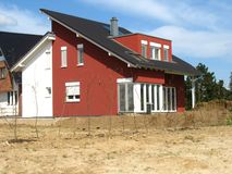 New red house. New house red house in a residential area Royalty Free Stock Photography