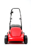 New red lawnmower on white background Royalty Free Stock Photos