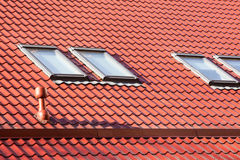 New red metal roof with skylights and Ventilation pipe for heat control. Royalty Free Stock Photos