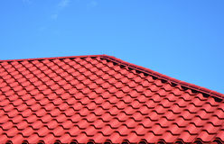 New red metal tiled roof house roofing construction exterior. Red metal tiled roof house roofing construction exterior Royalty Free Stock Photos