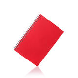 New red note book. Studio shot isolated on white Stock Photography