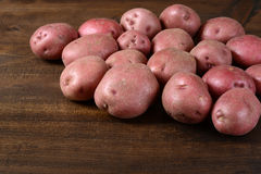 New red potatoes on wood Royalty Free Stock Image