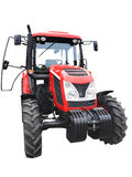 New red powerful tractor isolated over white Royalty Free Stock Image