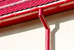 New red roof with gutter and snow guard stock images