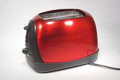 New Red Toaster. Shiny red and black toaster Stock Photo
