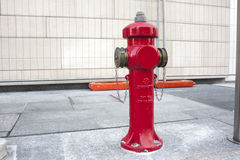 New red water pump for fire fighting, fire hydrant in the city Royalty Free Stock Photos