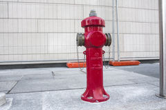 New red water pump for fire fighting, fire hydrant in the city Stock Images