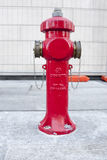 New red water pump for fire fighting, fire hydrant in the city.  Royalty Free Stock Photos