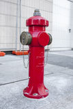 New red water pump for fire fighting, fire hydrant in the city.  Royalty Free Stock Photography