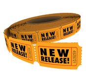 New Release Product Tickets Debut Premiere Passes. New Release words on a roll of tickets for admittance to a movie debut, premiere performance or concert Royalty Free Stock Photography