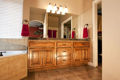 New Remodeled Bathroom. Custom wood cabinets in newly remodeled bathroom Stock Photo