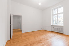 New renovated flat - apartment with wooden floor. New renovated flat / apartment , white walls - wooden floor royalty free stock images