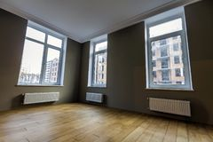 Free New Renovated Room Interior With Big Windows, Heating Radiators Stock Images - 109658924