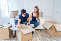 New repair and relocation. Loving couple enjoys a new apartment Royalty Free Stock Photography
