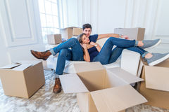 New repair and relocation. Loving couple enjoys a new apartment Royalty Free Stock Photos