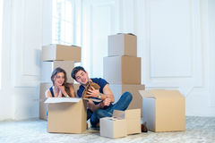 New repair and relocation. Loving couple enjoys a new apartment Stock Photos