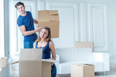 New repair and relocation. Loving couple enjoys a new apartment Stock Image
