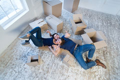 New repair and relocation. Loving couple enjoys a new apartment Royalty Free Stock Image