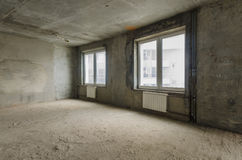 New residential apartment without finishing in  modern home. Concrete walls and Communications Royalty Free Stock Photo
