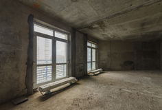 New residential apartment without finishing in  modern home. Concrete walls and Communications Stock Photography