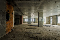 New residential apartment without finishing in  modern home. Concrete walls and Communications Royalty Free Stock Image