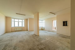 New residential apartment without finishing in  modern home. Concrete walls and Communications Stock Photos