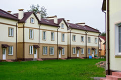 New residential area. / dwelling near Vladimir (Russia): architecture image with new houses / cottages / buildings for living and green lawn with grass between Royalty Free Stock Photography