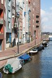 New residential area from Amsterdam along a canal with small boa Stock Photography