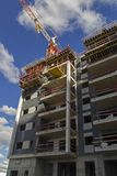New residential building with hgh rise tower crane construction. Site . Urban development theme. Sky and cloud background Royalty Free Stock Photo