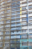 New residential building in scaffolding Stock Photo
