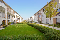 New residential building with walkway and outdoor facilities Royalty Free Stock Photos