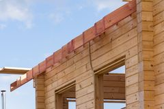 New residential construction home framing against a blue sky. royalty free stock photos