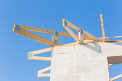 New residential construction home framing against a blue sky Royalty Free Stock Image