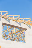New residential construction home framing against a blue sky Stock Image