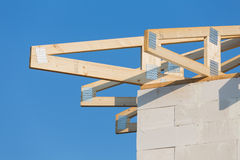 New residential construction home framing against a blue sky Stock Images