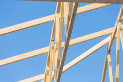 New residential construction home framing against a blue sky Royalty Free Stock Images