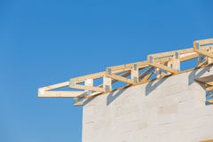 New residential construction home framing against a blue sky Royalty Free Stock Photo