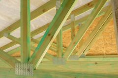 New residential construction home framing against a sunny sky.Local focus. stock photos