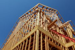New residential construction house framing against a blue sky. Royalty Free Stock Photography