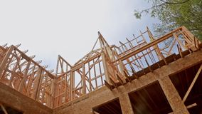 New residential construction house framing against a blue sky. stock video footage