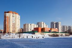 New residential homes with kindergarten on the river bank. Balashikha, Russia. New residential homes with kindergarten on the bank of the river Pekhorka. People Royalty Free Stock Photo