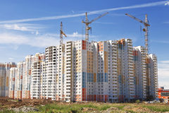New residential houses and construction cranes Stock Photos