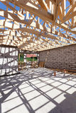 New residential wooden construction home framing. Building a roof with wooden balks. New residential wooden construction home framing. Building a roof with royalty free stock image