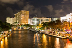New River in downtown Ft Lauderdale at night, Florida, USA. Night view of New River with Riverwalk promenade highrise condominium buildings and yachts in Fort Royalty Free Stock Images