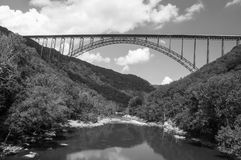 New River Gorge Bridge. A black and white image of the New River Gorge Bridge from New River Gorge, the bridge is the longest steel spanning bridge in the Royalty Free Stock Image