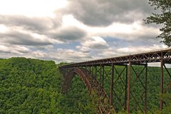 New River Gorge Bridge. A shot of the New River Gorge Bridge with great cloud cover and brilliantly green foliage Stock Image