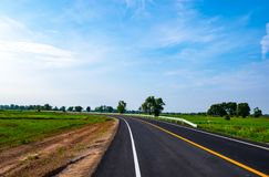 Beautiful blue sky over the new road in the morning at countryside landscape of Thailand. New road and beautiful blue sky background in the morning at royalty free stock photo