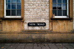 New road sign in Oxford. On dirty wall and littered street Royalty Free Stock Photography