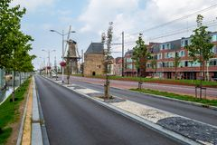 A new road and a tramway along the old city mill and watch tower stock images